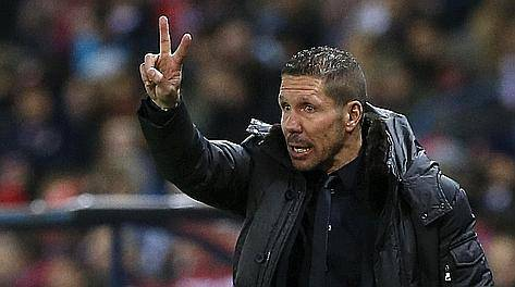 Atletico Madrid's coach Diego Simeone gestures during their Spanish first division soccer match against Getafe at the Vicente Calderon stadium in Madrid