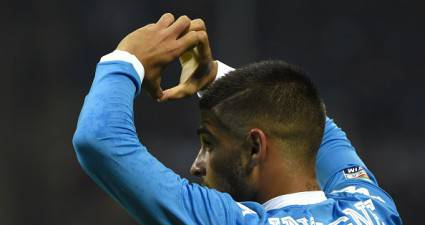 Napoli's Italian midfielder Lorenzo Insigne celebrates after scoring during the Italian Serie A football match between AC Milan and Napoli at San Siro Stadium in Milan on October 4,  2015. AFP PHOTO / OLIVIER MORIN        (Photo credit should read OLIVIER MORIN/AFP/Getty Images)
