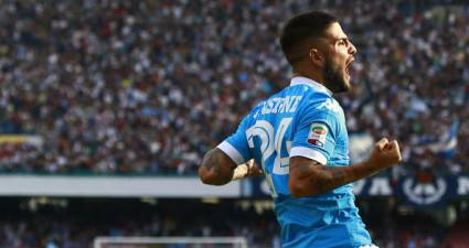 Napoli's Italian forward Lorenzo Insigne celebrates after scoring during the Italian Serie A football match SSC Napoli vs ACF Fiorentina on October 18, 2015 at the San Paolo stadium in Naples. AFP PHOTO / CARLO HERMANN        (Photo credit should read CARLO HERMANN/AFP/Getty Images)