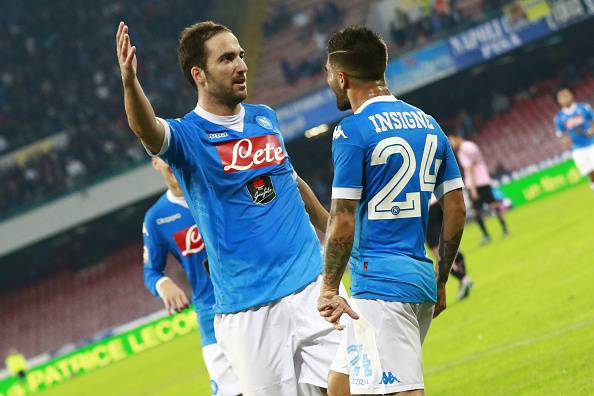 Napoli's Argentinian-French forward Gonzalo Higuain (L) celebrates with teammate Napoli's Italian forward Lorenzo Insigne after scoring during the Italian Serie A football match SSC Napoli vs US Palermo on October 28, 2015 at the San Paolo stadium in Naples. AFP PHOTO / CARLO HERMANN        (Photo credit should read CARLO HERMANN/AFP/Getty Images)